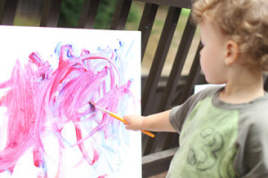 little-boy-painting-on-easel